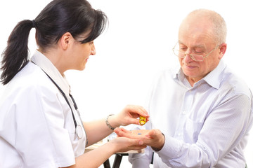 Doctor giving the medicine to a senior man
