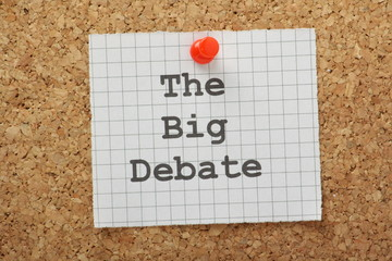 The Big Debate concept on a cork notice board