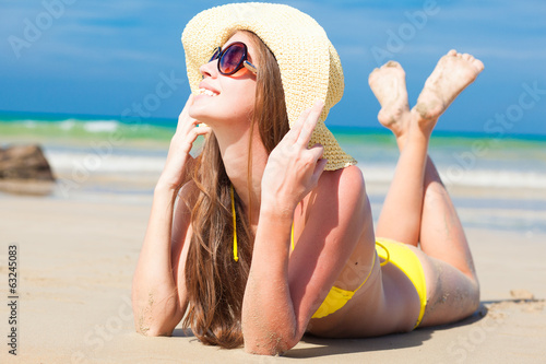 long haired happy young woman in bikini smiling on tropical