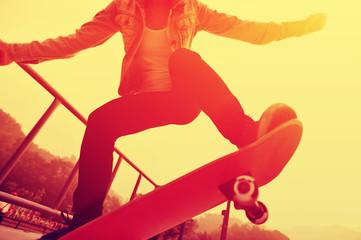 skateboarding woman on sunrise skatepark