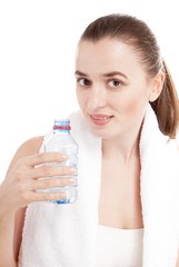 Young  woman with bottle of water covering white background.