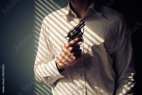 Man with gun by window