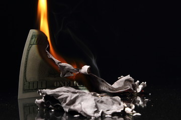 One hundred dollars in fire, burning dollar, ashes