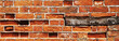 Red brick wall background texture with wooden plinth.
