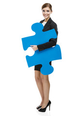 Businesswoman with a puzzle piece