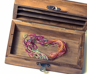 thread heart in wooden box