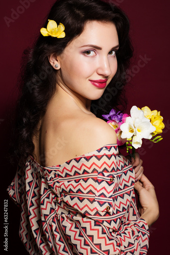 Pretty brunette lady with fresia flowers