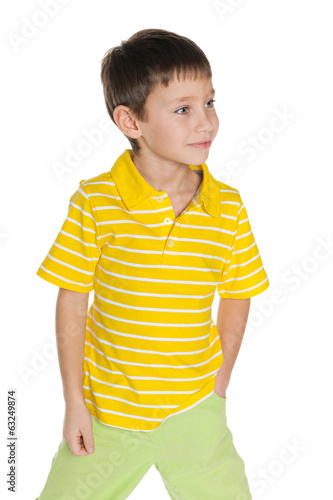 Walking young boy in yellow shirt