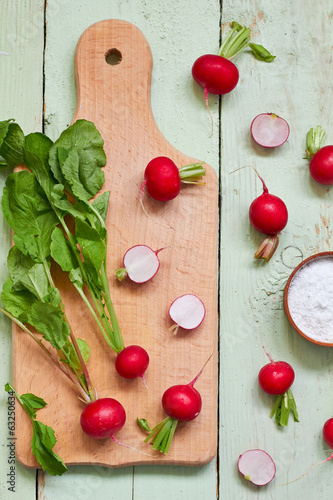 Fresh radish on wooden cutting board