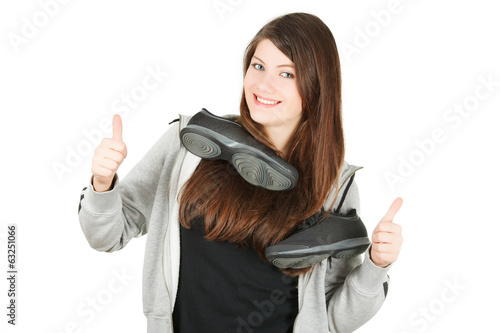 sport girl with trainers on a neck