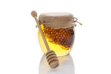 Honey jar with wooden dipper.