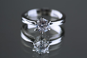 Beautiful diamond ring on gray background