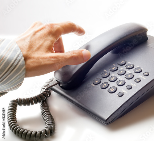 The businessman calling by phone. - 63251639