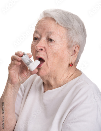 Senior woman with asthma inhaler