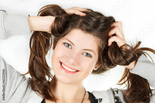 a portrait of girl is in a sportwear that twirled hair hands
