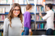 Smiling female student in a library