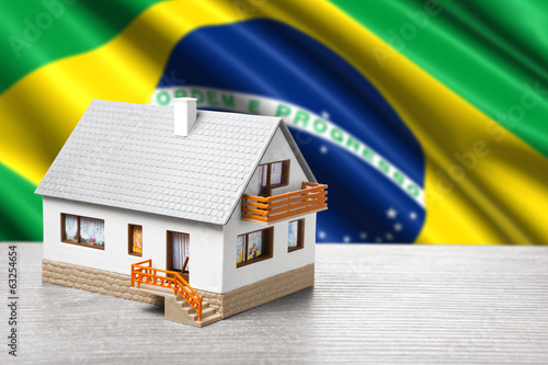 classic house against Brazilian flag background