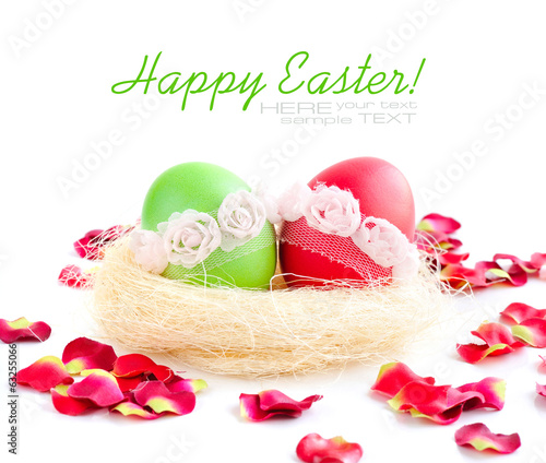 Easter eggs in a nest on white background