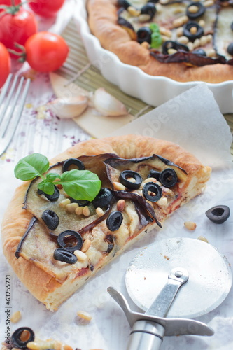 Vegetarian pie with eggplants, olives and pine nuts