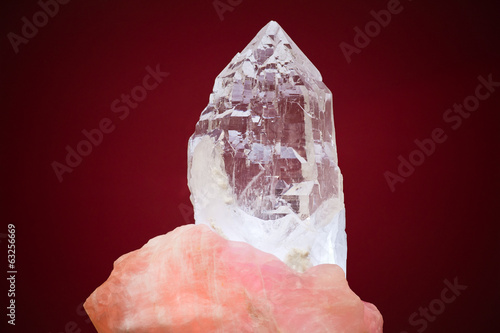 Large crystal of white quartz on red background