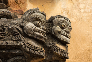 statue of two faces on the facade of ancient temple in Bagan(Pag