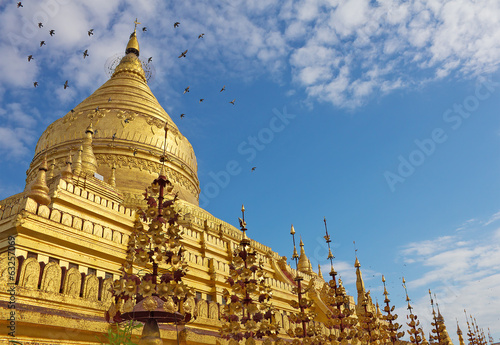 Shwezigon Pagoda(Paya) with flying doves in Bagan