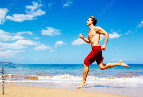 Athletic Man Running on Beach