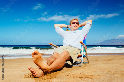 Young Successful Entrepreneur Relaxing on the Beach