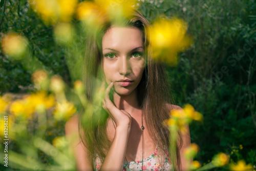 Beautiful blonde in a summer field