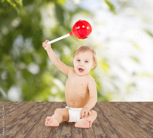 cute little boy playing with big lollipop