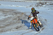 motocross rider performs a right turn with the skid