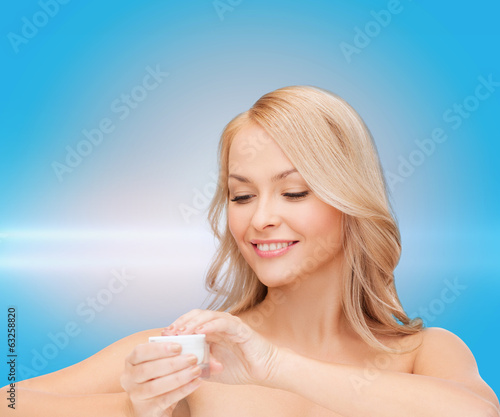 beautiful woman applying cream
