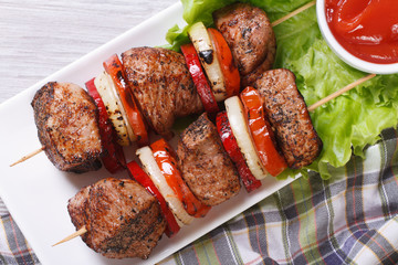 shashlik with vegetables and sauce top view