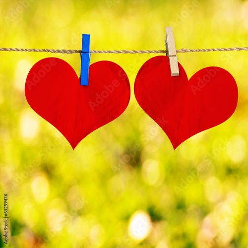 Red heart shape on note paper attach to rope with clothes pins o