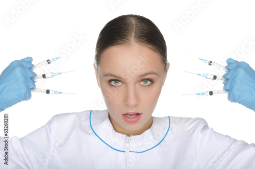 Doctor in gloves holding syringe front of face
