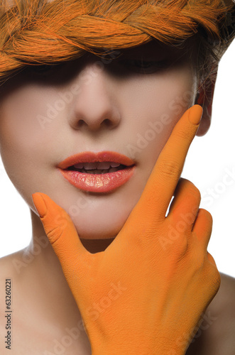 Vertical portrait of woman in orange