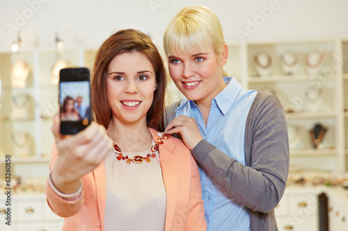 Women taking selfie while shopping