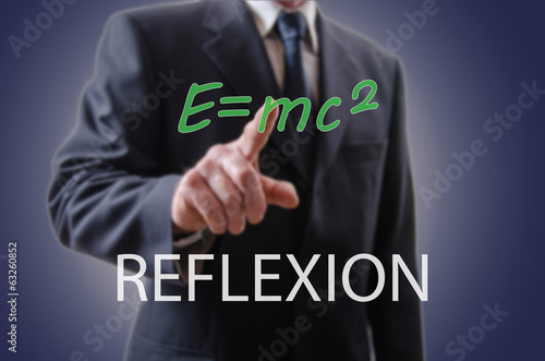 Businessman indicating the reflexion