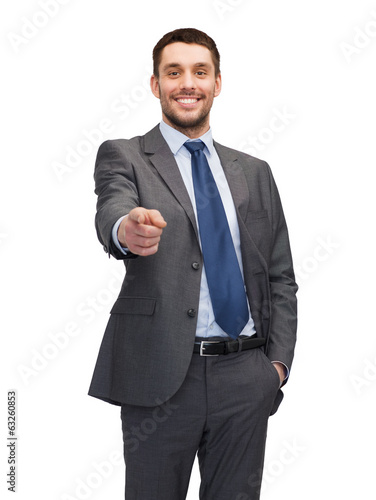 handsome buisnessman pointing finger at you
