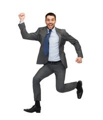 smiling businessman jumping