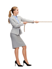 smiling businesswoman pulling rope