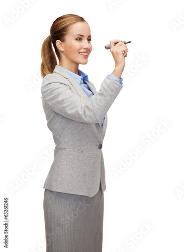businesswoman writing something in air with marker