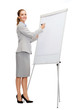 smiling businesswoman writing on flip board