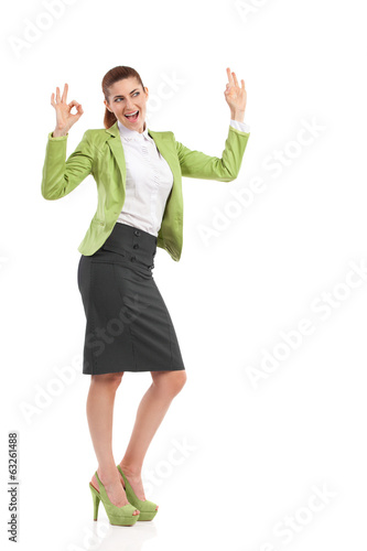 Ecstatic mid adult woman showing ok sign.