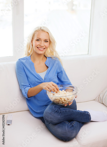 young girl with popcorn ready to watch movie