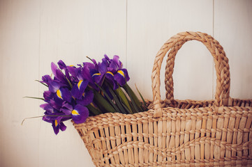 wicker basket with spring flowers