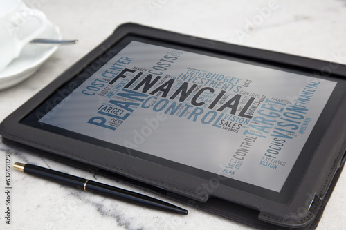 tablet with financial word cloud