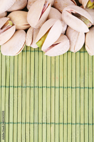 Pistachio nuts on bamboo background