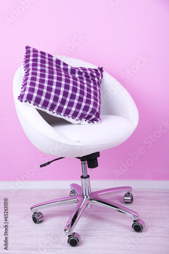 Modern chair in room on pink background