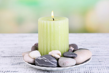 Composition with spa stones, candle